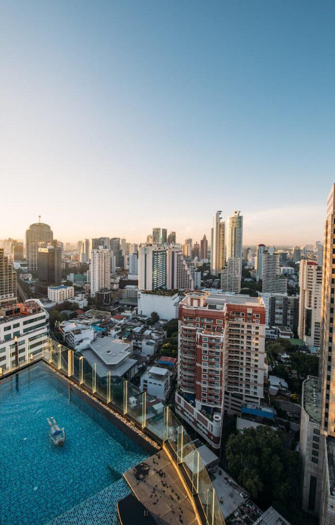 thailand bangkok the-continental morning hotel pool sunrise woman