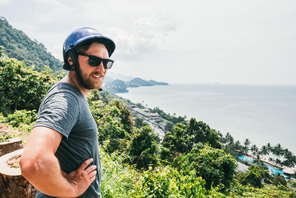 thailand koh-chang island sea coast man palm-tree scooter-tour