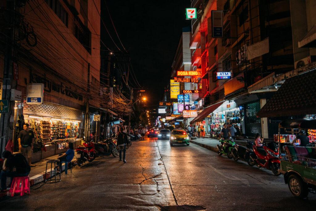 thailand bangkok street life signs shops car