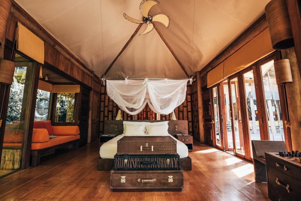 thailand koh-kood soneva-kiri hotel palm-tree bungalow bed room