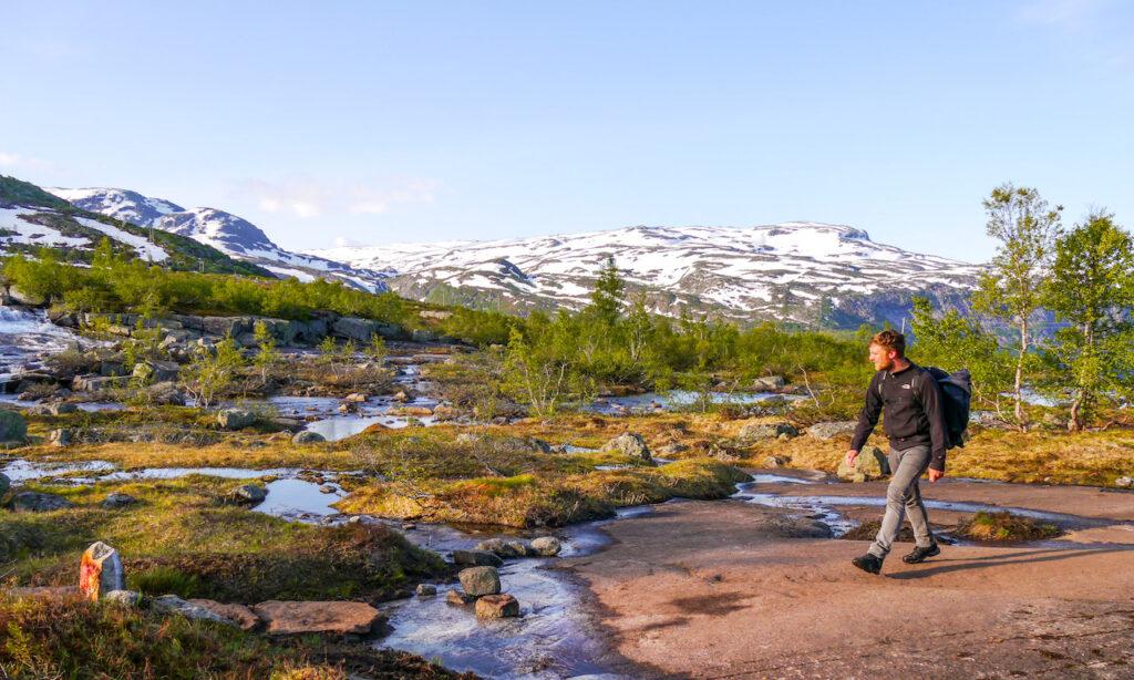 norway hiking men tree snow rock mountain