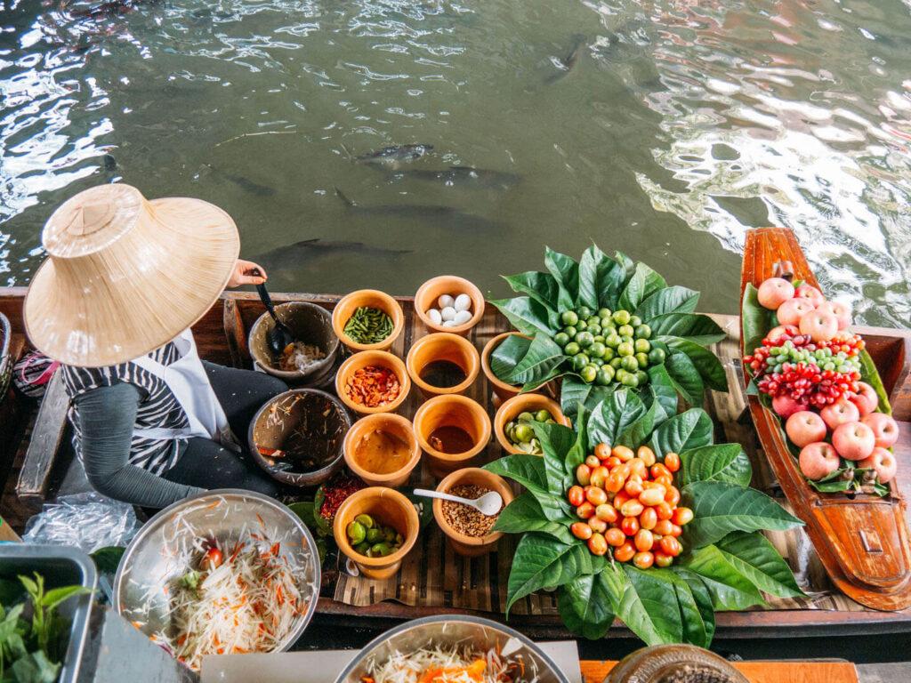 thailand taling-chan floating-market bangkok water boats food woman
