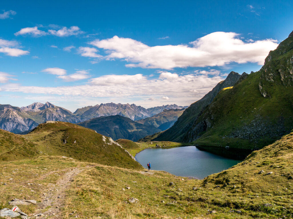 montafon vorarlberg hiking lake water woman mountain