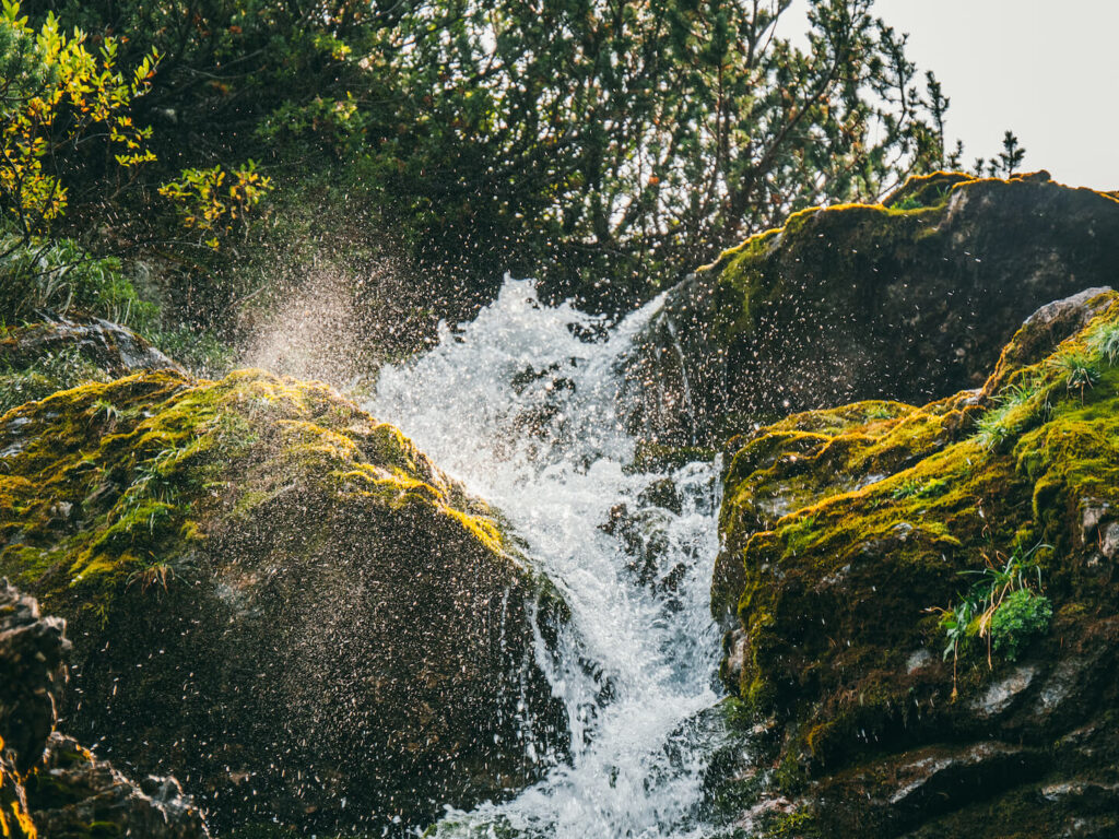 vorarlberg lech zuers lechweg hiking woman waterfall water sun lech river