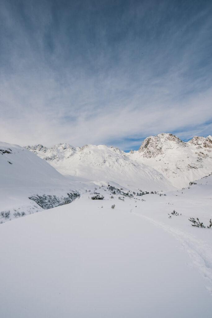 vorarlberg montafon silvretta silvrettasee snowshoeing winter hiking snow mountains sky