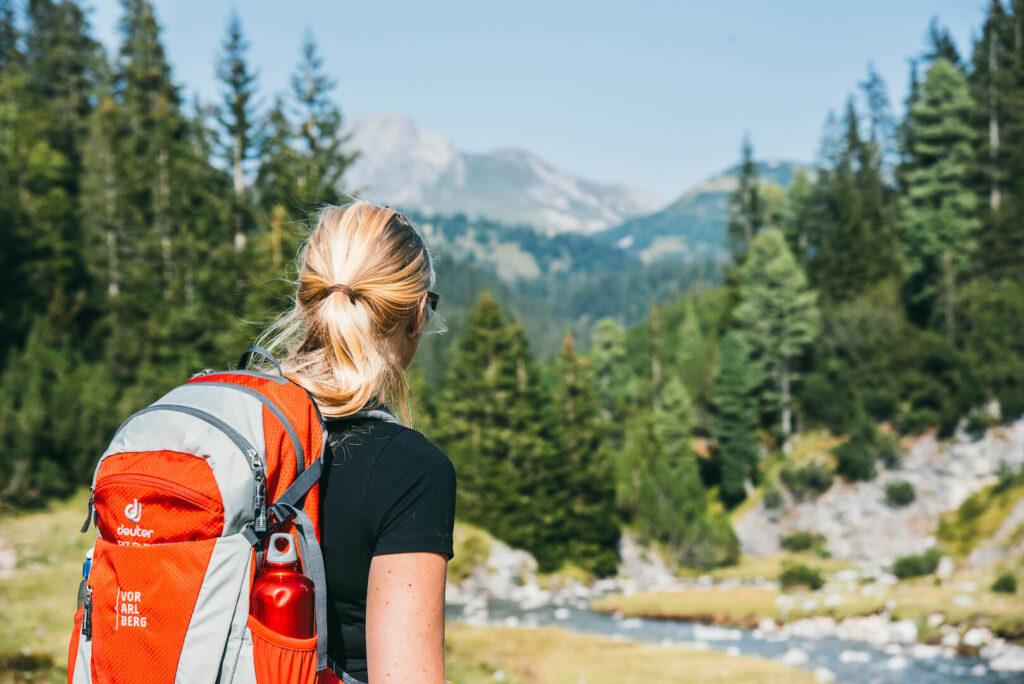 vorarlberg lech zuers lechweg first-stage hiking woman tree lech river