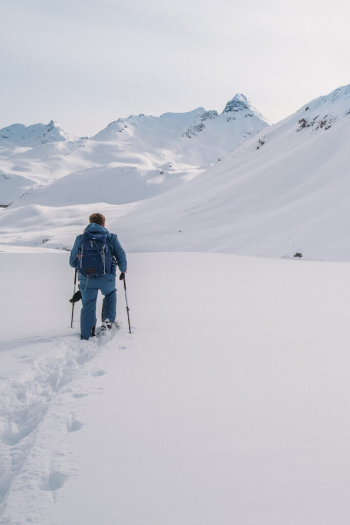 vorarlberg montafon silvretta silvrettasee snowshoeing winter hiking snow mountains man