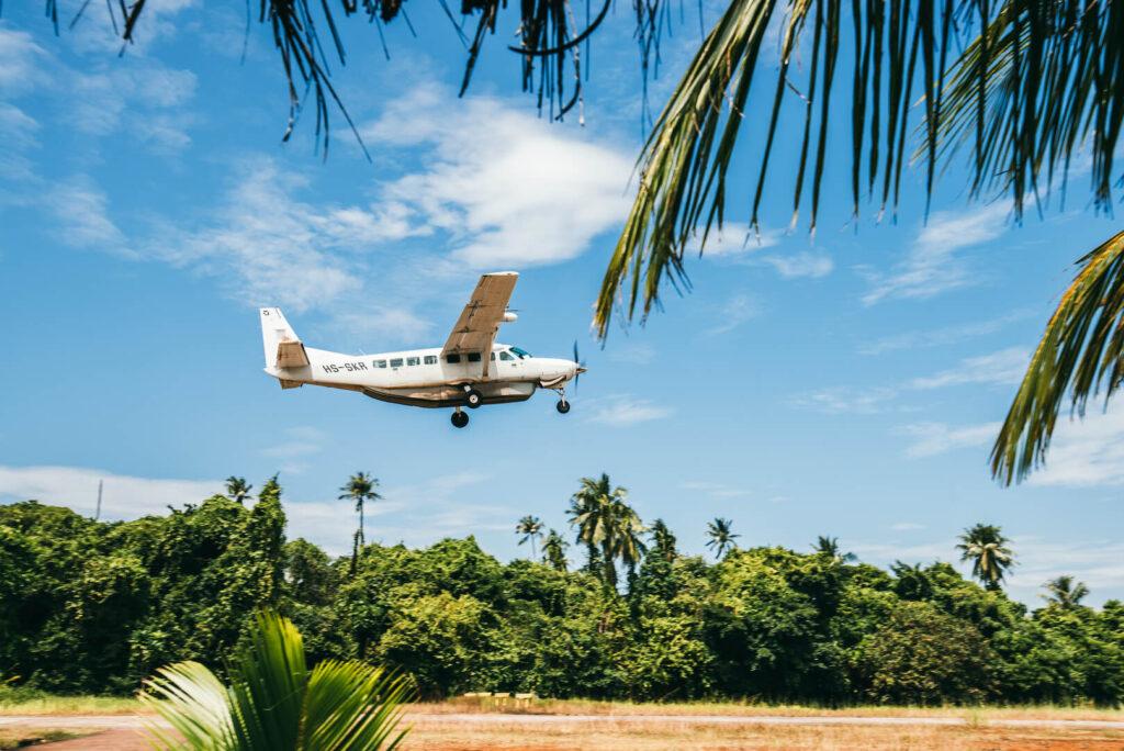 thailand koh-kood soneva-kiri sky clouds palm tree plain airport