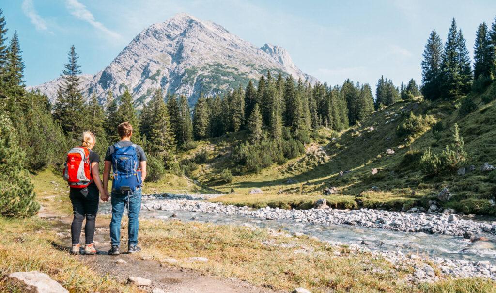 vorarlberg lech zuers lechweg first-stage hiking woman river man lech mountain