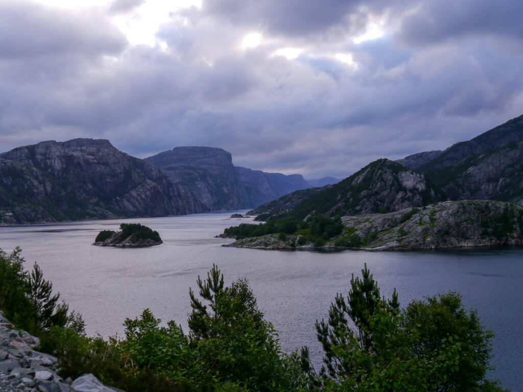 norway fjord water rock island mountain tree blue-hour
