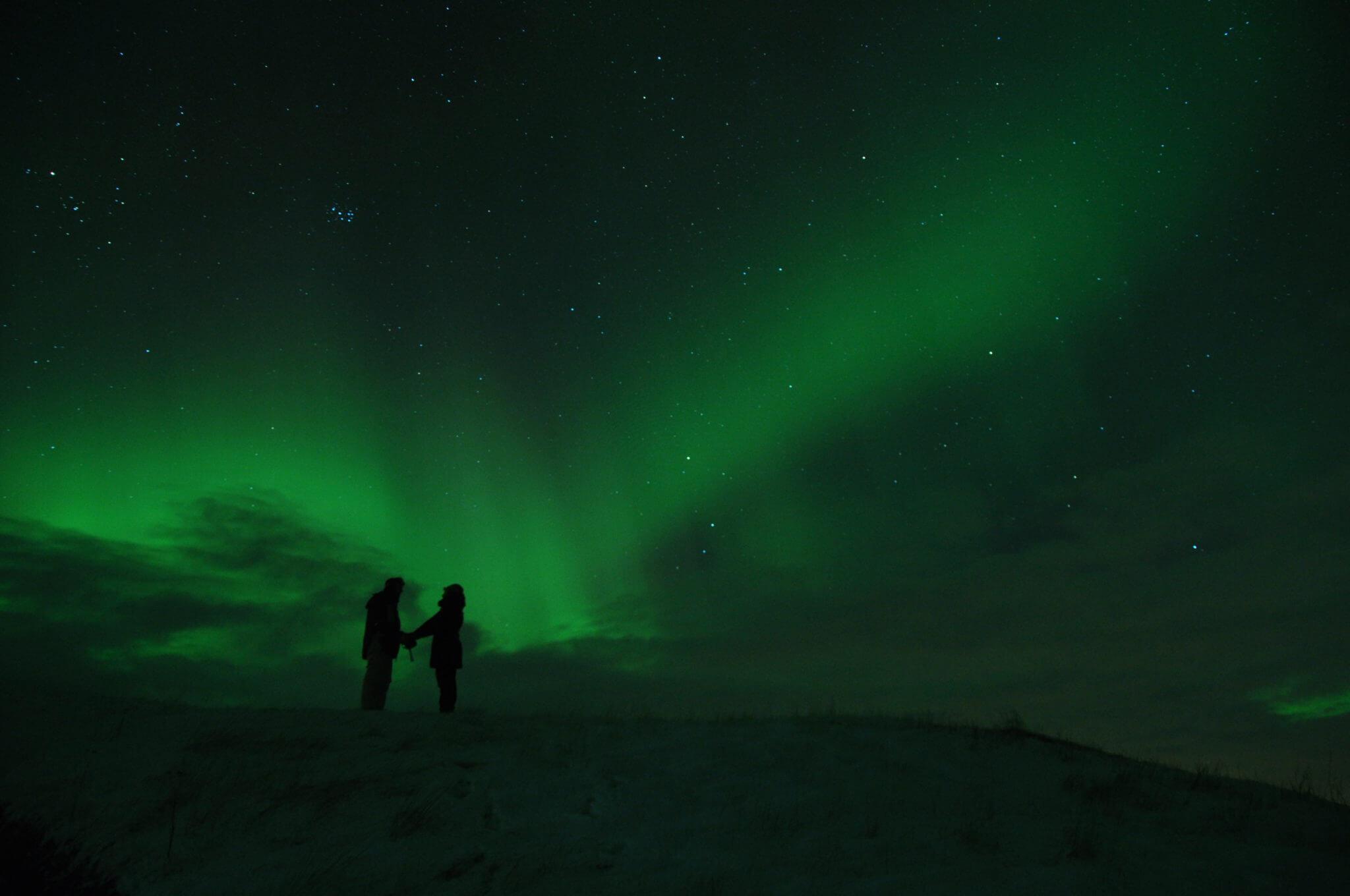 northern-lights green dark men women star