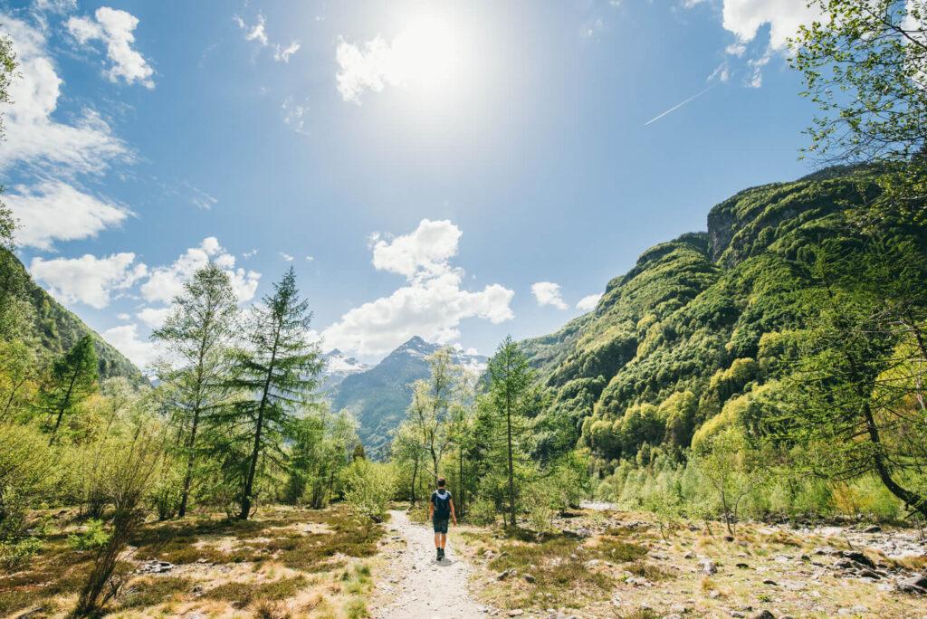 switzerland ticino verzasca-valley hiking clouds mountain sun man
