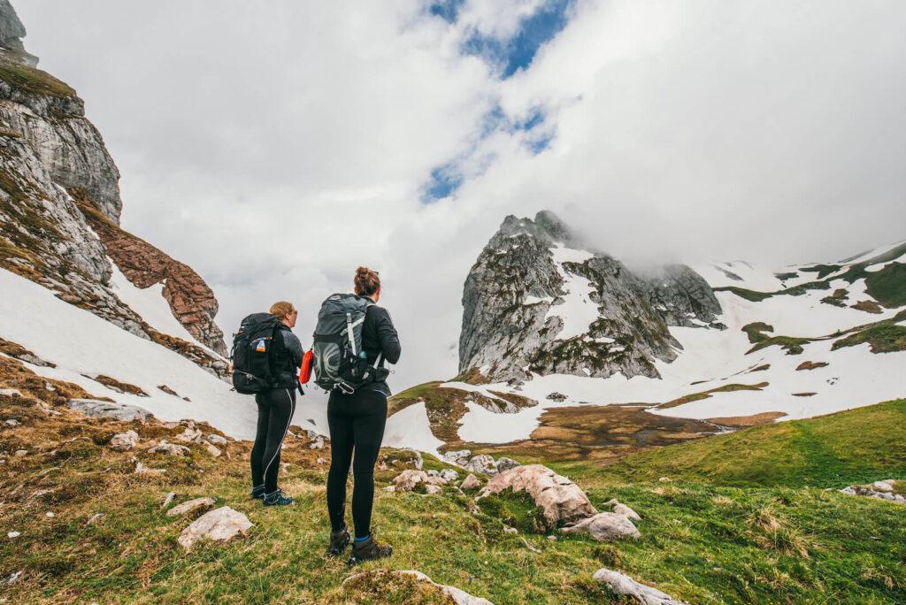 vorarlberg schweizer-tor hiking clouds montafon snow mountains woman