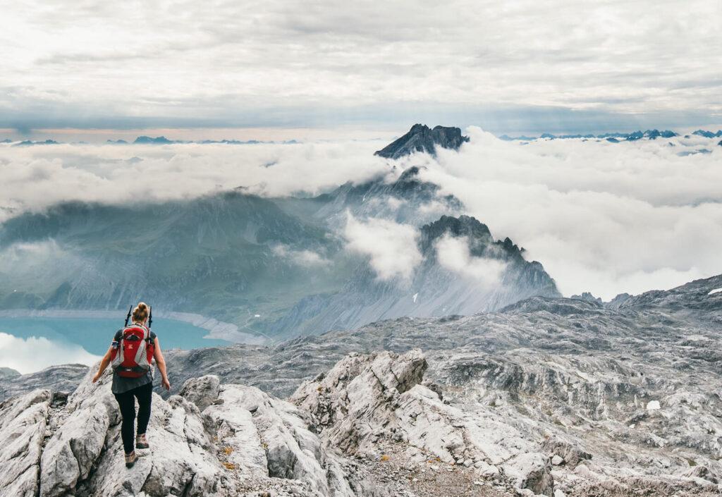 vorarlberg lünersee hiking rätikon woman clouds lake mountain