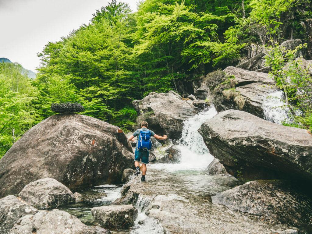 switzerland ticino verzasca-valley hiking water river man rocks trees
