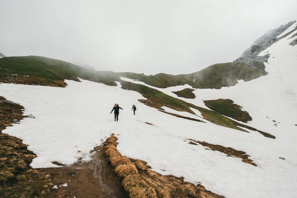 vorarlberg rätikon lünersee hiking clouds montafon snow mountains woman