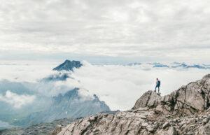 vorarlberg lünersee hiking rätikon man clouds lake mountain