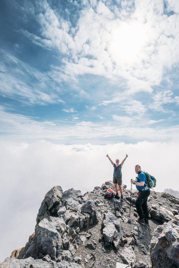 vorarlberg lünersee schesaplana hiking rätikon clouds mountain man peak woman