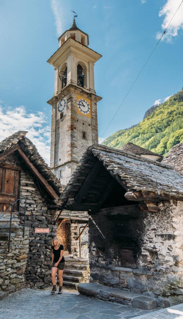 switzerland ticino verzasca-valley sonogno church woman hiking