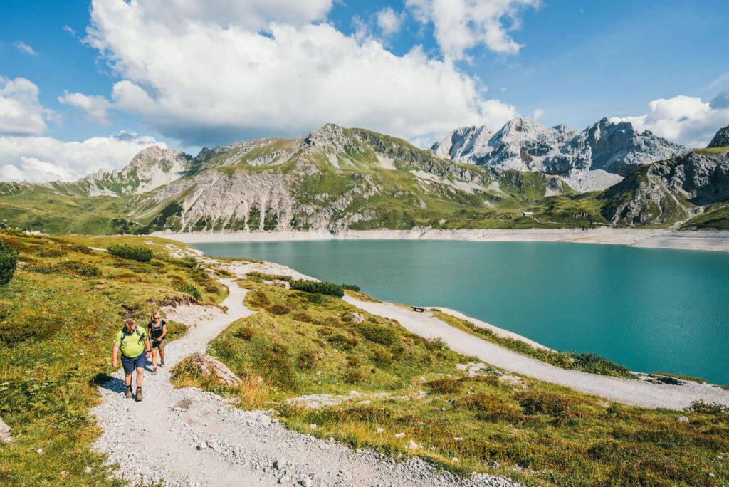 vorarlberg lünersee hiking lake rätikon mountain woman clouds man