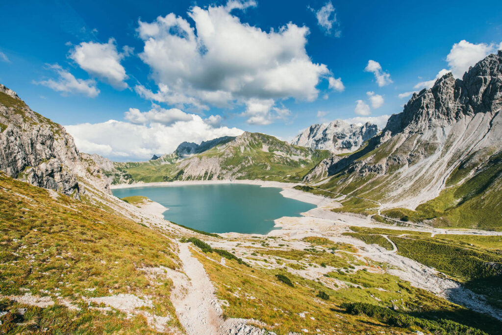 vorarlberg lünersee hiking lake rätikon mountain woman clouds totalphütte