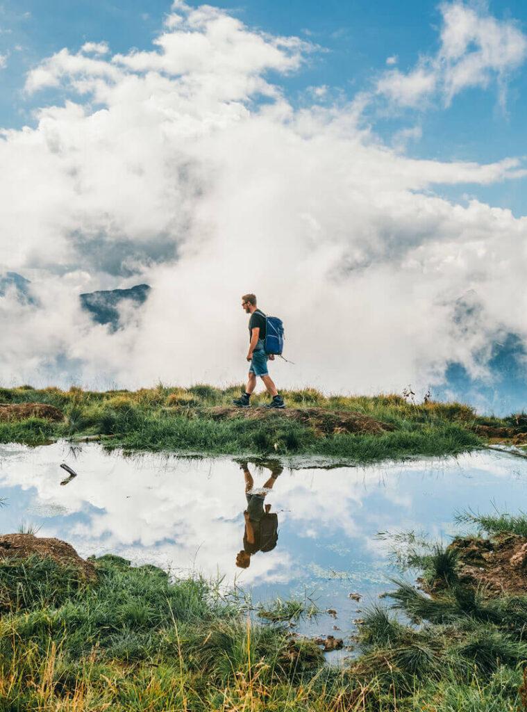 vorarlberg bregenzerwald bezau winterstaude hiking clouds man mirror