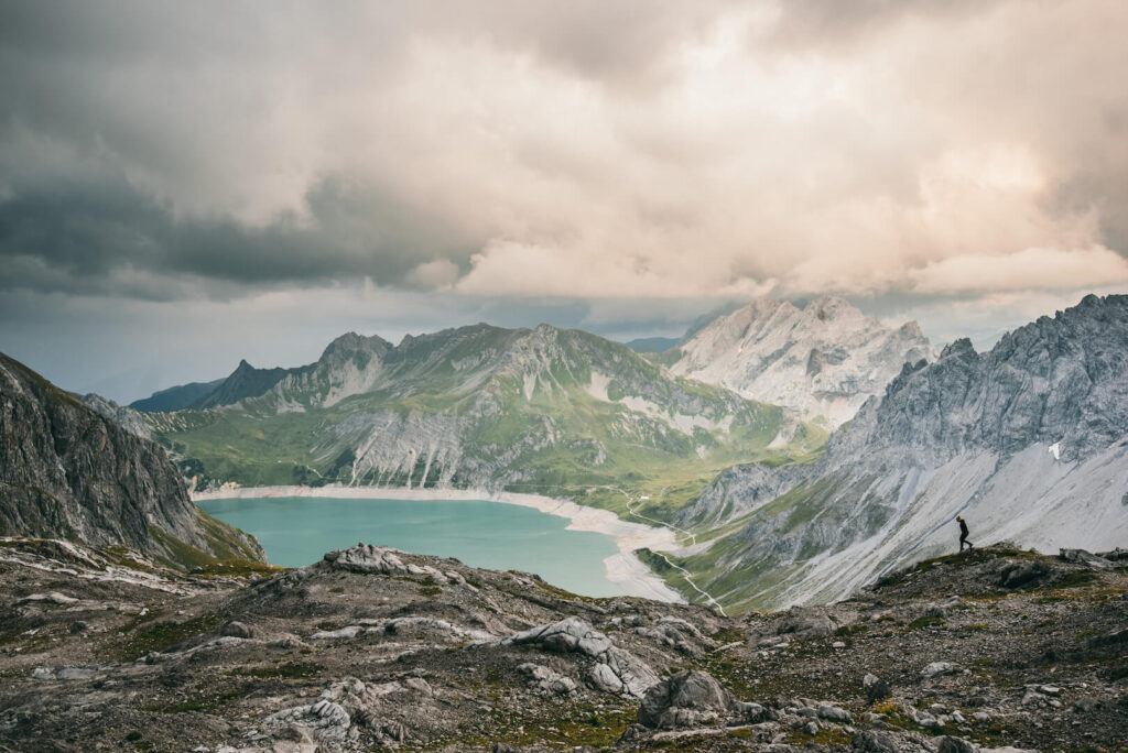 vorarlberg lünersee hiking lake rätikon mountain clouds totalphütte woman