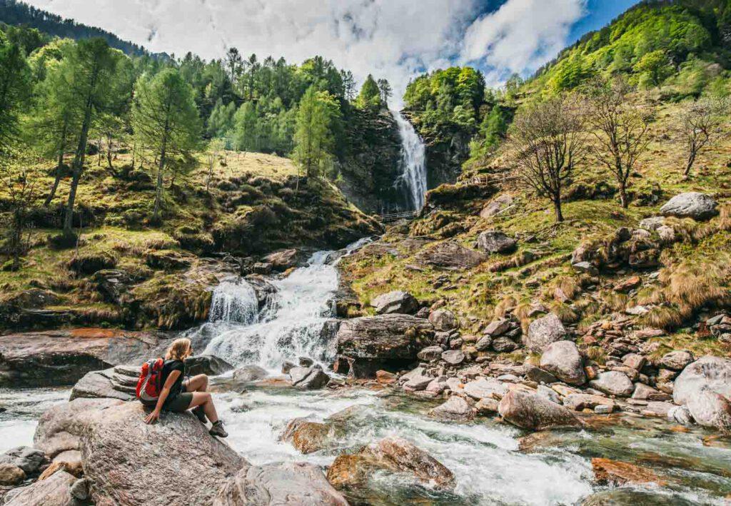 switzerland ticino cascata-la-froda verzasca-valley waterfall sonogno hiking woman