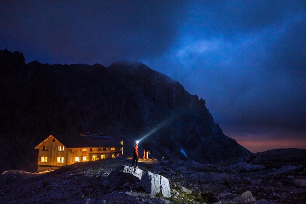 vorarlberg lünersee hiking rätikon mountain night woman clouds totalphütte hut